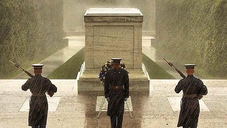 NOT SANDY: A famous viral photos from Sandy of three soldiers in uniform at the Tomb of the Unknown Soldier in Arlington, Virginia. It was actually taken in September.