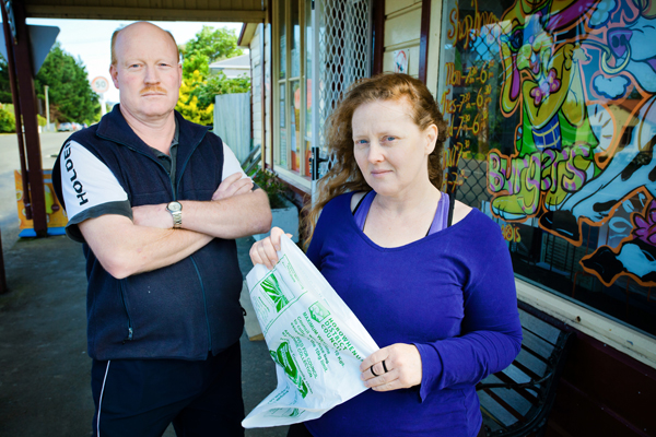 Pricey bags: Tokomaru Store owner Mike Davis and local resident Rebecca Louth with one of the council rubbish bags.