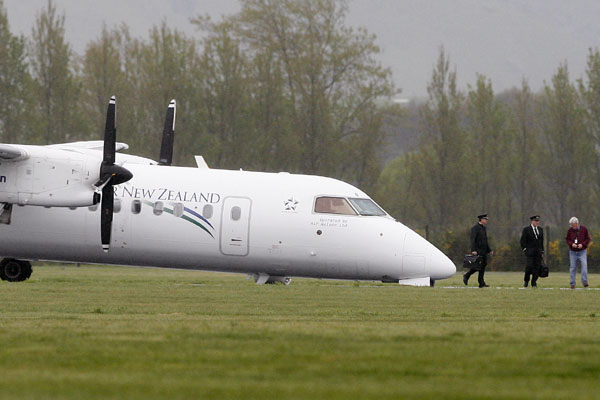 NOSEDIVE: The Bombardier Dash 8 Q-300 made a crash landing at Blenheim Airport after a problem with the front wheel.