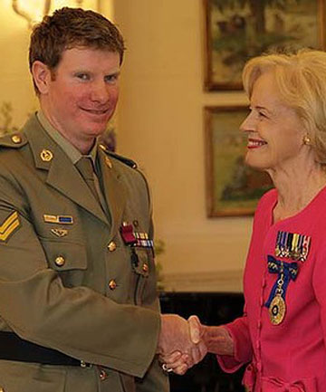 Corporal Daniel Keighran is awarded a Victoria Cross by Australia Governor General Quentin Bryce.