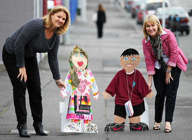 BONDING BUDDY: Buddy day organisers Heather Claycomb, left, and Jacqui Humm take to the streets with their buddies.