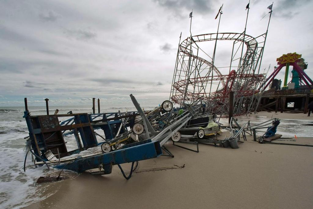 Remnants of rides at FunTown Amusement Pier rest on the shoreline three days after Hurricane Sandy came ashore in Seaside Heights, New Jersey.