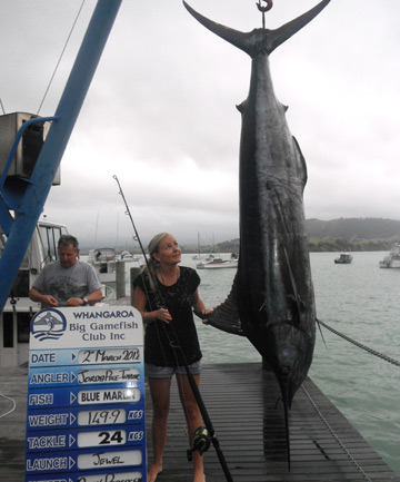 Jorda Pike-Taylor sizes up the 149.9kg blue marlin she caught during the Whangaroa Sport Fishing Club's ladies weekend.