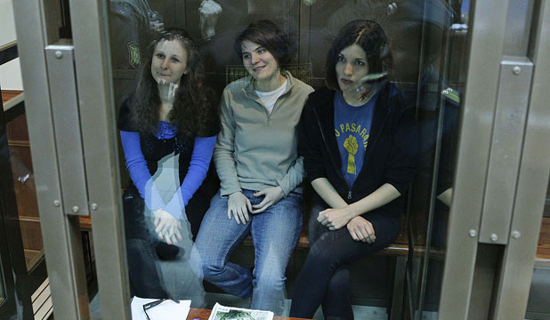 PUNKS' APPEAL DELAYED: Members of the punk band Pussy Riot (from left) Maria Alyokhina, Yekaterina Samutsevich and Nadezhda Tolokonnikova sit in a glass-walled cage before a court hearing in Moscow.