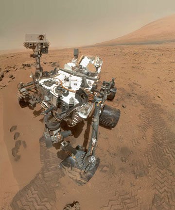 CURIOSITY: Cruising Mars in the Gale Crater near Mount Sharp.