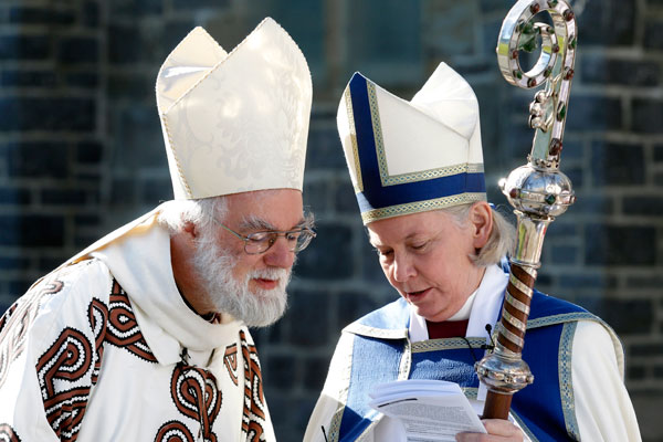 The Archbishop Rowan Williams and Bishop Victoria Matthews at Christ's College for a service at the college chapel.