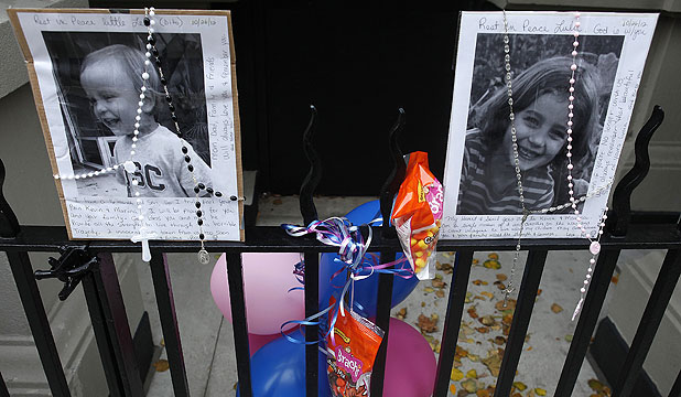 SHOCK OVER KILLINGS: A makeshift memorial is left outside the Krim family apartment in New York.