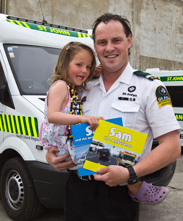 PINT-SIZED INSPIRATION: Anja Andrews, 4, checks out an ambulance cab with Blair Andrews, her father, who is an advanced paramedic.