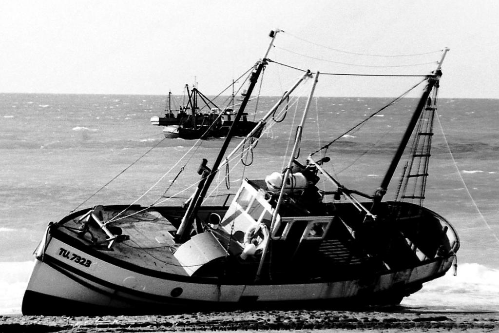 """ROUGH SEAS: What brought this boat to the shore? Several possible stories were floated about this mystery photo, including several people who thought the boat had run aground south of Timaru, near St Andrews. But two commenters were in agreement that the boat is the FV Kaka and the grounding happened  about 1975. One commenter  said: """"On this day the boat had been set up to do a survey on salmon. The trolling poles that were put on the boat by the front mast altered the magnetic compass, but this went unnoticed, and while steaming up to the Opihi River mouth in the dark on what was thought to be the correct compass course, the vessel ran aground. The vessels in the background are the Enterprise, Apollo and the Poitrel. (The Kaka) was successfully refloated."""""""