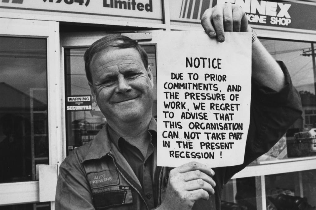 """TOUGH TIMES? This is Don Campbell, of Auto Engineers, in Edward St taken in the late 1980s. The original Herald caption, which Auto Engineers was able to supply, read: """"The notice he is holding appears on the front door of his premises.  I know people say times are tough, but you have to be positive or you get nowhere.  I believe there is a future in Timaru for people prepared to give good service and quality of workmanship. We are very busy. The sign means what it says ... we haven't time to worry about a recession."""" Our commenter added: """"The sign applies today as well, as we are very busy."""""""