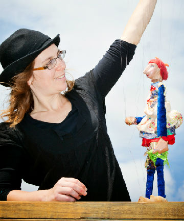 Travel buddies: Anna Bailey with one of the puppets which have taken her from au pair to globetrotter.
