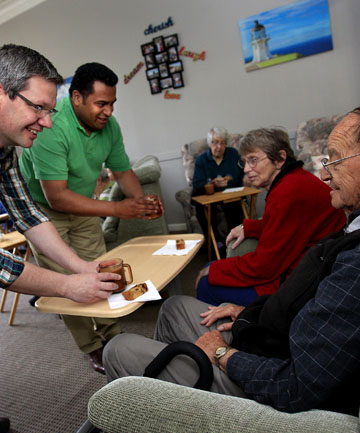 VOLUNTARY LABOUR: Labour MPs Iain Lees-Galloway (Palmerston North) and Kris Faafoi (Mana) spent a couple of hours working at Wimbledon Villa Rest Home in Feilding on Sunday. They serve afternoon tea and cakes to residents Jeanette Brown and Noel Broughton.