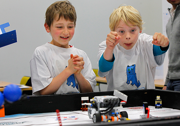 IF YOU BUILD IT... Peri Shaw, 8, and David Laing-Maguire, 10, from Hataitai School's Cubic Cats team, compete in the Lego Robotics Challenge at Victoria University.
