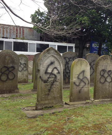 DEFACED: Jewish graves in Symonds St Cemetery were desecrated with swastikas and expletive-ridden messages.