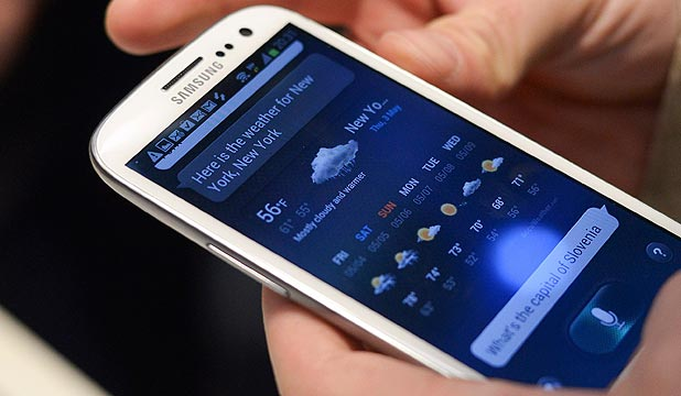 GOING BOLDLY: A man holds a Samsung Galaxy SIII smartphone during its launch at The Earls Court Exhibition Centre in London.