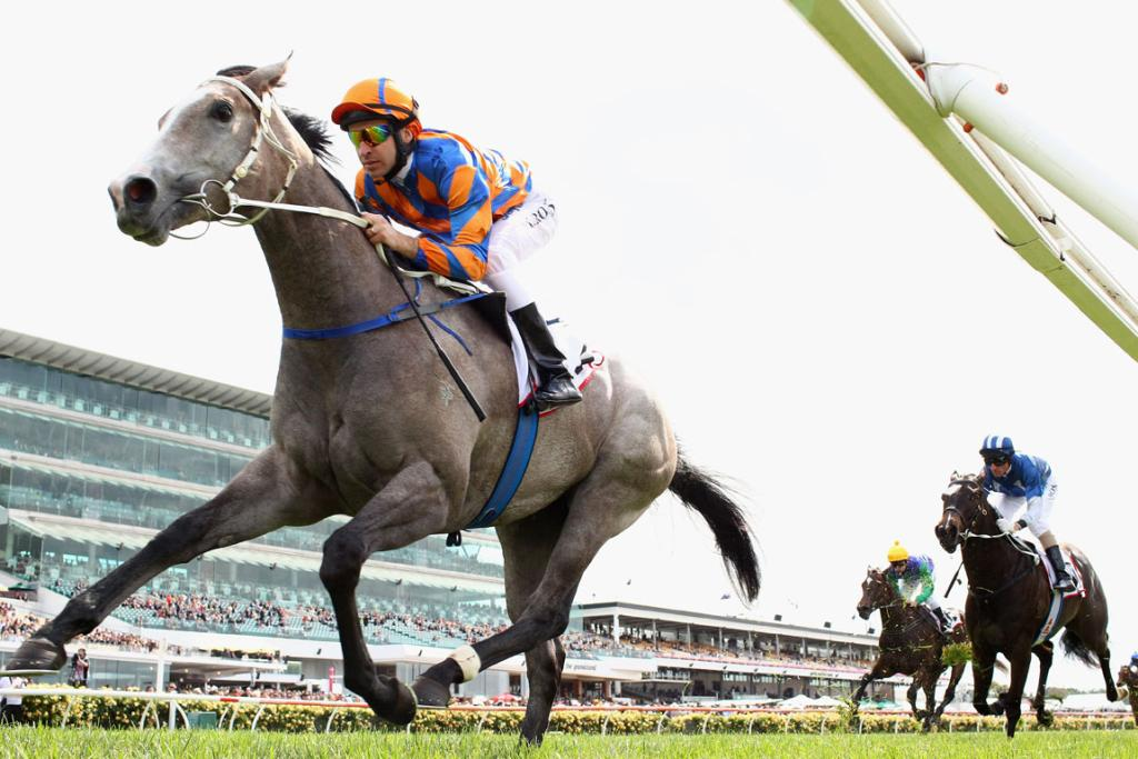 Michael Rodd riding Villa Verde wins race one the 7News Plate during 2012 Melbourne Cup Day at Flemington.