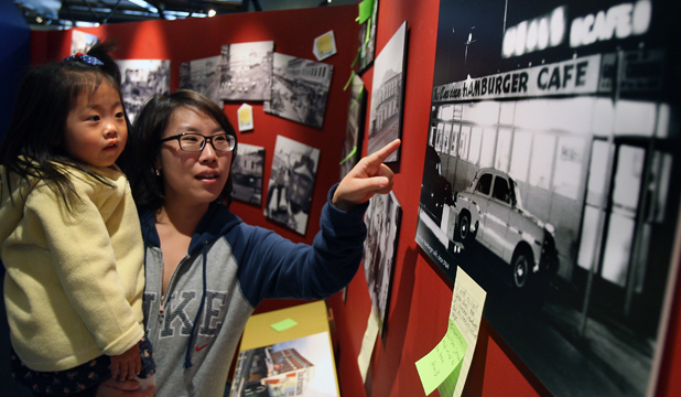 RETRO BOOST: Seung Hye Cho and daughter Yu-Jeong Kim, 3 , of Timaru view photographs at the Downtown exhibition in the South Canterbury Museum.