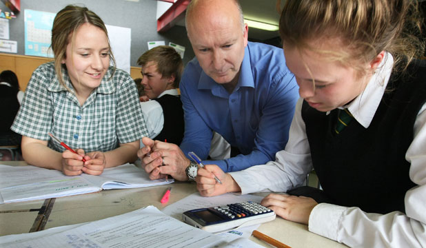 Verdon College pupils Grace Dowling, 16, and Alannah Webster-Blair, 15, get study help from teacher Stephen Alcock before NCEA exams begin on Friday.