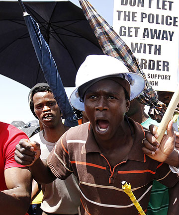 DEAL REACHED: Striking miners sing during a strike at the AngloGold Ashanti mine in Carletonville, northwest of Johannesburg, last month.