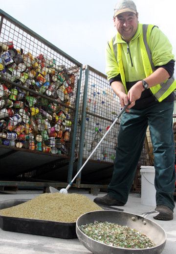 Just the job: Jamie Moffit practises his swing using Innovative Waste Kaikoura's new product, silica sand