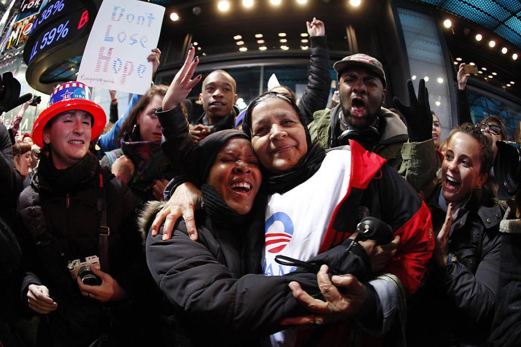 People celebrate in New York's Times Square after President Barack Obama was projected to win the US presidential election.