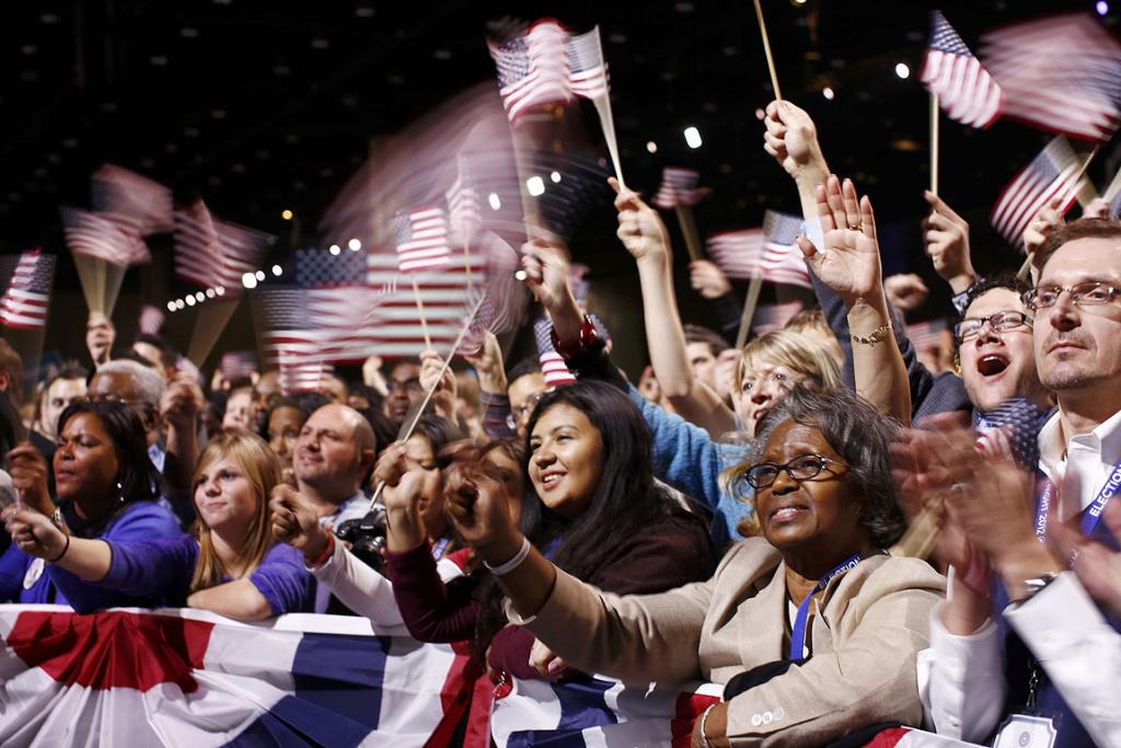 Supporters wave flags and listen to President Barack Obama's victory speech in Chicago.