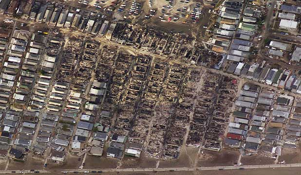Burnt houses surrounded by houses that survived is seen in the aftermath of Hurricane Sandy in the Breezy Point neighbourhood of Queens, New York.