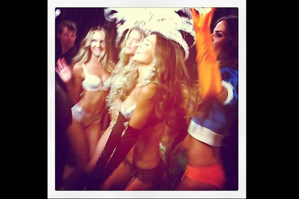 Some of the Victoria's Secret models rocking out to Justin Bieber during taping of the show.