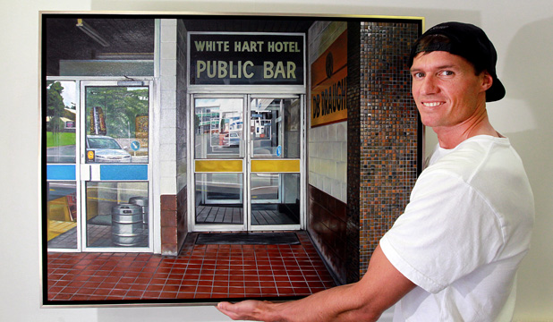 PICTURE PERFECT: Artist Isaac Petersen with one of his paintings, Public Bar, which will be on show during his exhibition Home & Away which opens tomorrow.