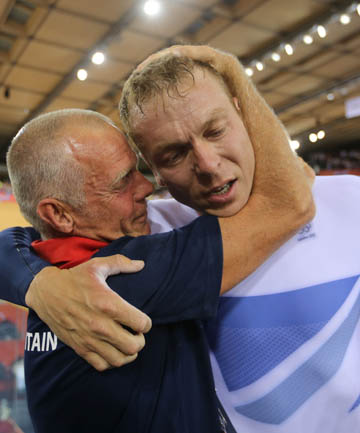 SECOND CRASH: Shane Sutton hugs Chris Hoy at this year's Olympics. He has been hospitalised after a crash just a day after Bradley Wiggins.