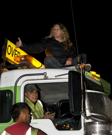 ARRESTED: At least one protestor was arrested after she climbed a removal truck and refused to come down.