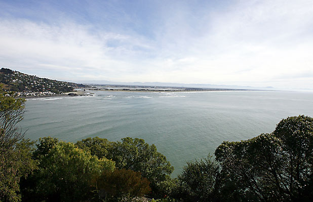 MILLION DOLLAR VIEW: Homes on Whitewash Head Rd look out across the sea to the city and Southern Alps.