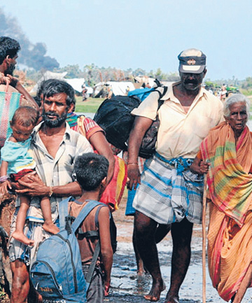 PUSHED OUT: People flee an area held by the Tamil Tigers in northeastern Sri Lanka in 2009.