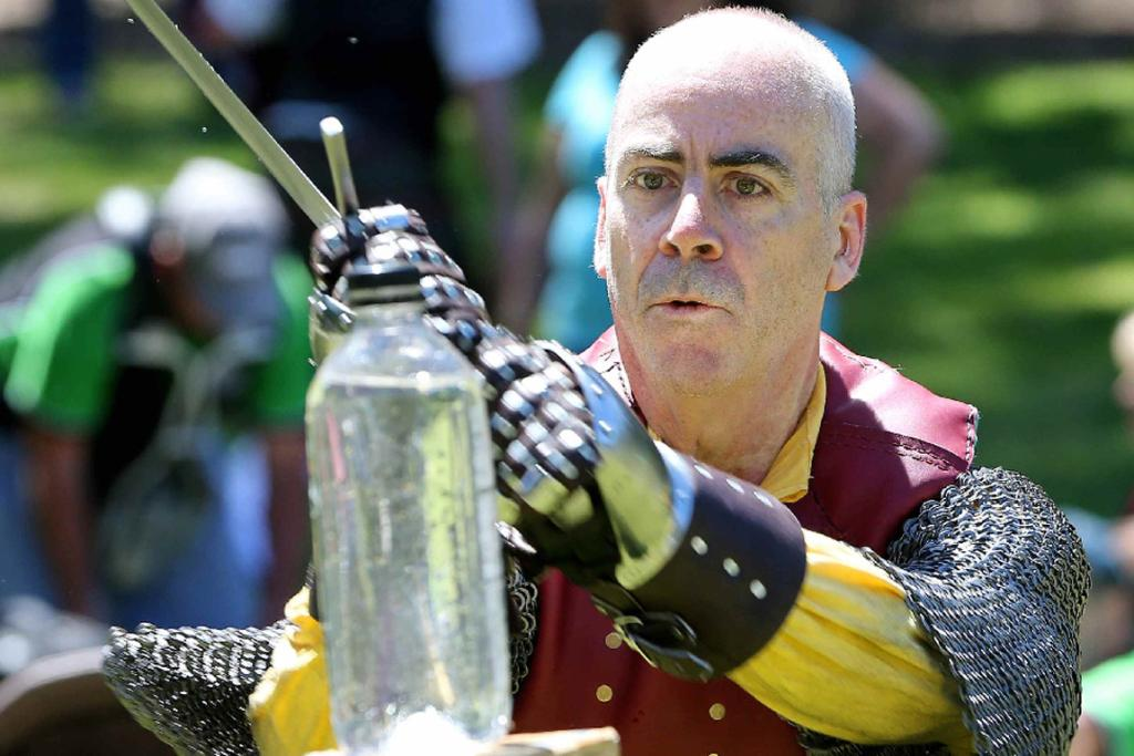 Swordsman Mike O'Hara cleaves a bottle in two at the Upper Hutt Highland Gathering.