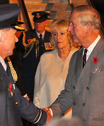 REGAL ARRIVAL: Prince Charles  and his wife, Camilla, arrive at the RNZAF base in Auckland for the start of their tour of New Zealand.