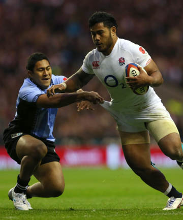 ROMP: Manu Tuilagi of England runs in his side's seventh try over Fiji.