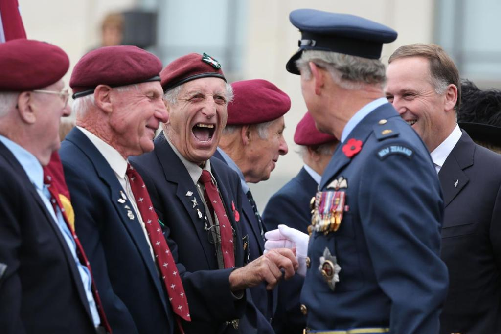 Prince Charles with New Zealand Prime Minister John Key shake hands with Kiwi veterans from the British Airborne Forces during the Armistice Day commemorations held outside the Auckland War Memorial Museum.
