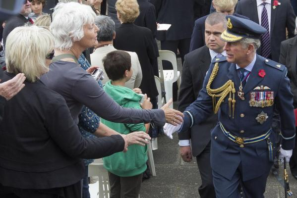 Prince Charles shakes hands with members of the public after the Armistice Day commemoration service held outside the Auckland War Memorial Museum.