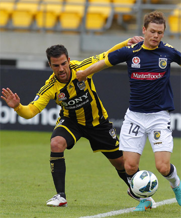 BALL WINNER: Manny Muscat (left) battles for possession with Michael McGlinchey.