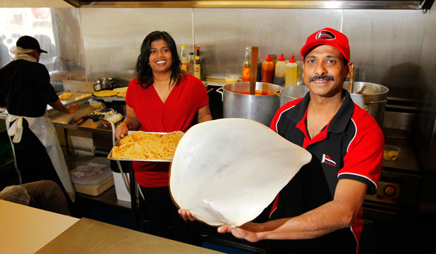 Rempah Foods owners Caroline and Reuben Danam prepare authentic Malaysian food in their Miramar premises.