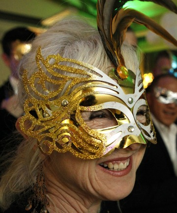 MASK TIME: Bev Guy-Hales gets into party mode at The Pride Festival masquerade opening party at the CBD bar.