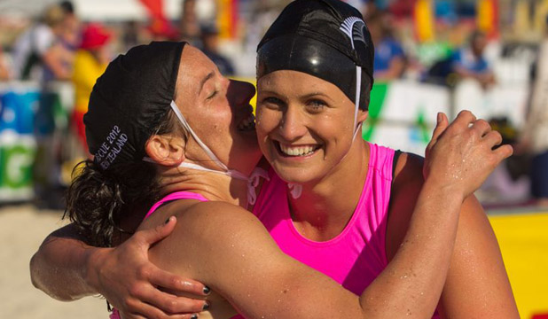 PURE ELATION: Devon Halligan and Nikki Cox celebrate their gold and silver medal-winning performance in the women's ski race on the final day of the Rescue 2012 world lifesaving championships in Adelaide.