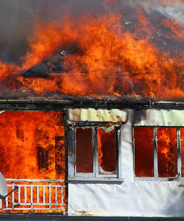 INFERNO: The Allenby Terrace house was well ablaze in a fire in September 2011.
