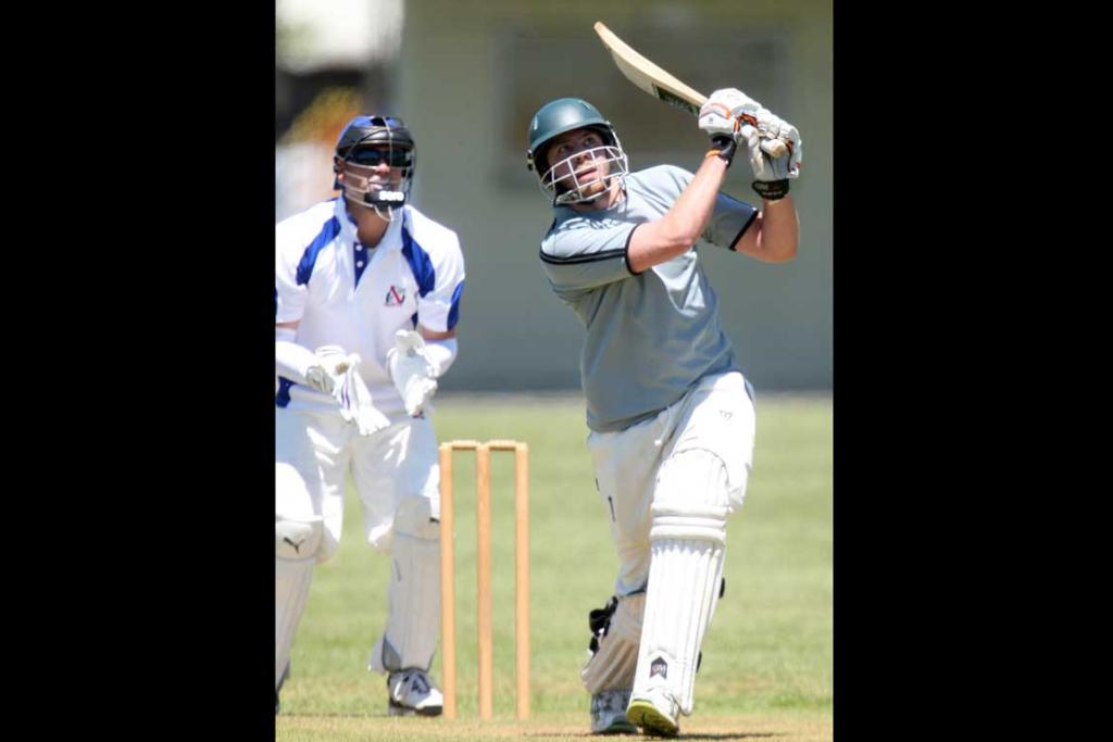 Manukau batsman Anthony Niterl hits a six.