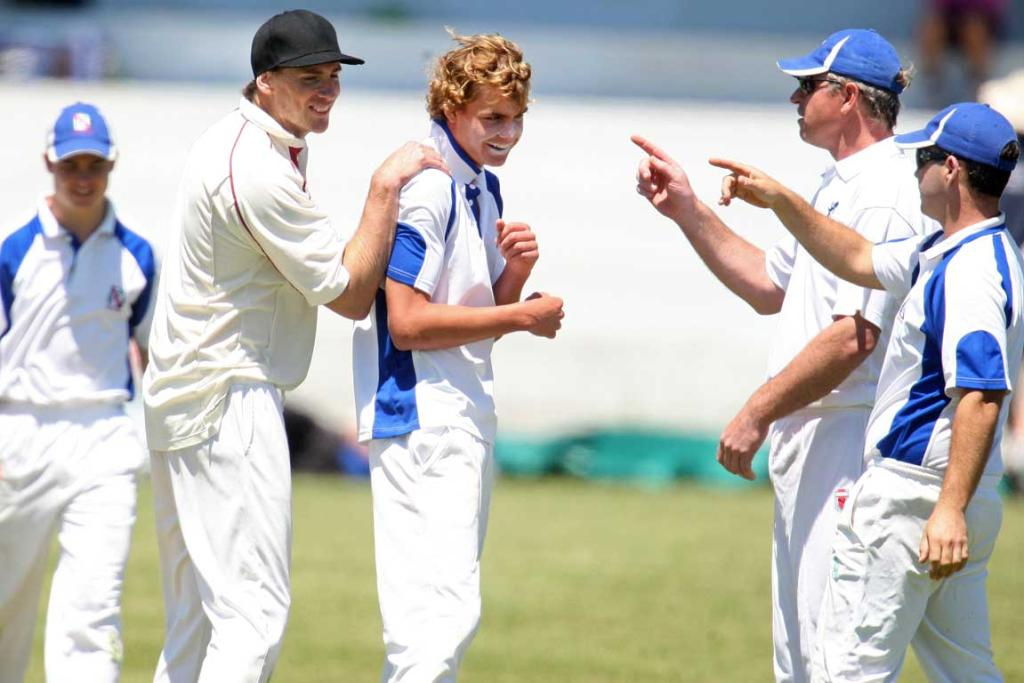 Papakura spinner Harley Jenkins gets a pat on the back after claiming the wicket of Manukau batsman Ashwin Herwels.