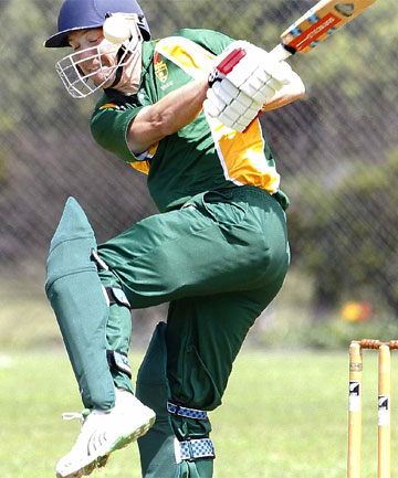 COP THAT: University's Geoff Willmott is struck on the helmet while batting against Naenae Old Boys.