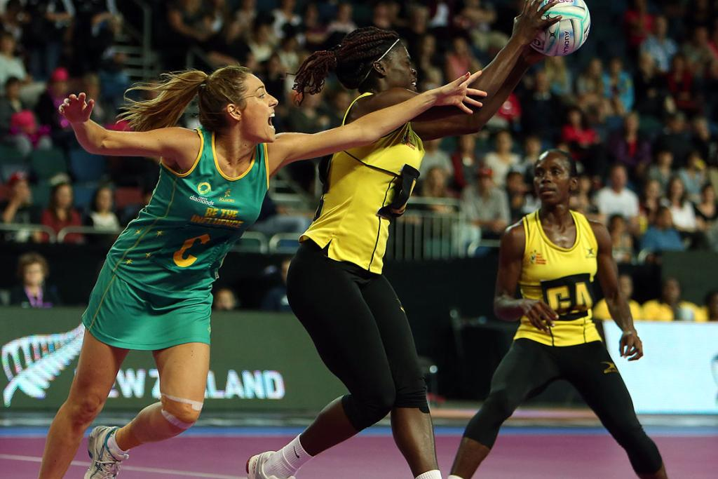 Jamaica's Kimone Tulloch and Australia's Elissa Macleod in action during match between Jamaica and Australia at the Fast5 Netball World Series at Vector Arena.