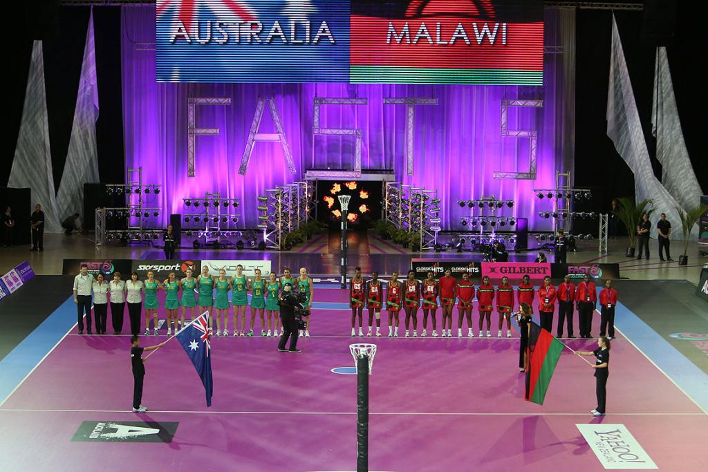 Teams line up before the match between Malawi and Australia at the Fast5 Netball World Series at Vector Arena.