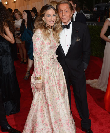 DESIGNED TO SUIT: Valentino, pictured with Sarah Jessica Parker in one of his designs.