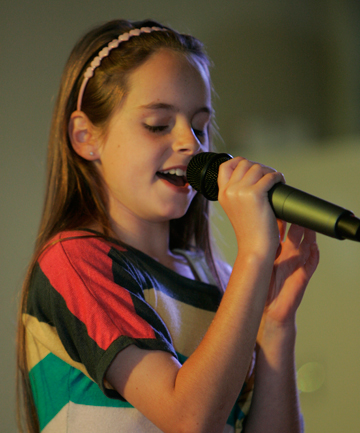 STAR QUALITY: Junior solo winner Ester Terrill performs during the Richmond heat of Tasman's Got Talent at the Richmond Town Hall on Saturday.